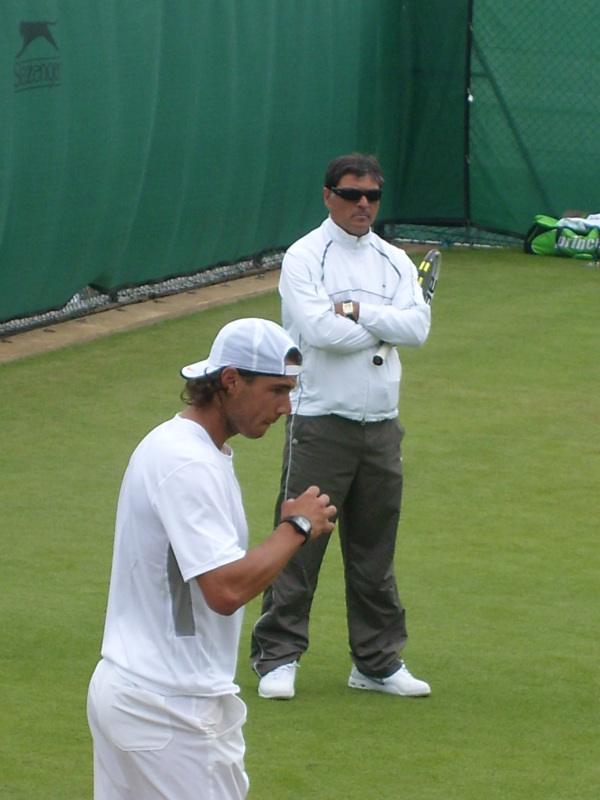 Rafael Nadal, practicing his serve with the support of Uncle Toni