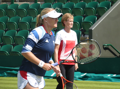 Judy watching over Elena during her warm up before her match with Ana Ivanovic
